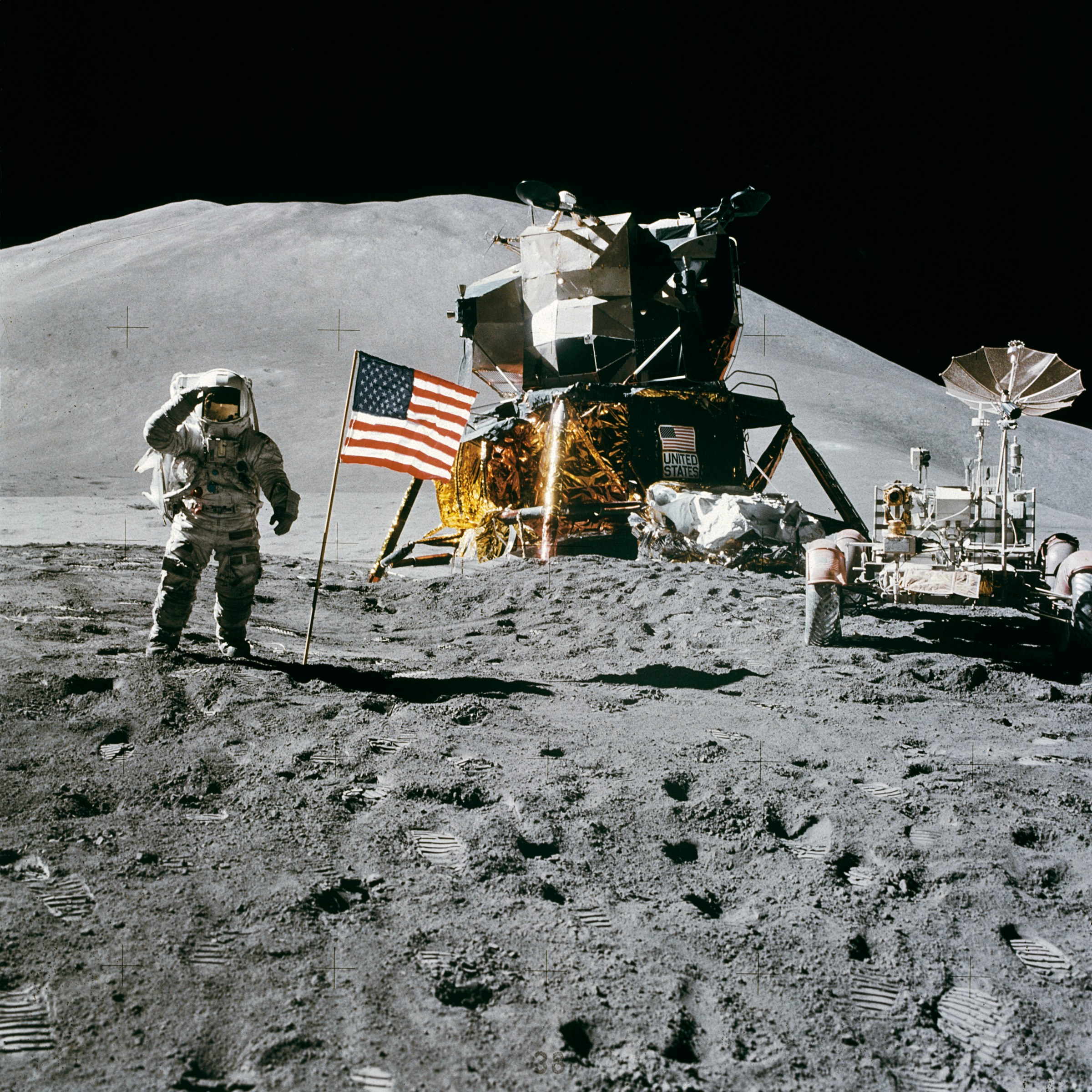 Astronaut James B. Irwin, lunar module pilot, gives a military salute while standing beside the deployed U.S. flag during the Apollo 15 lunar surface extravehicular activity (EVA) at the Hadley-Apennine landing site on the moon.