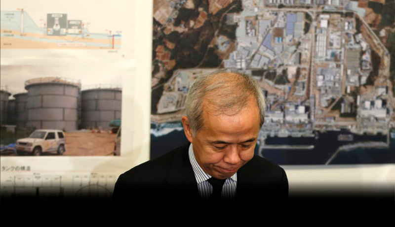 TEPCO President Naomi Hirose bows in apology for the contaminated water leakage after a related meeting at TEPCO headquarters in Tokyo on September 13, 2013.