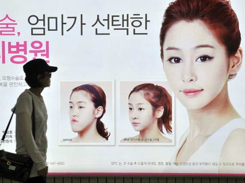 Advertisements for Korean plastic surgery clinics crowd the walls of Seoul's subway stations and buildings.