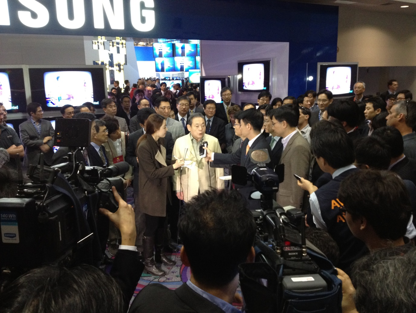 Samung Group Chairman Lee Kun-hee speaks to reporters at the 2012 CES in Las Vegas.
