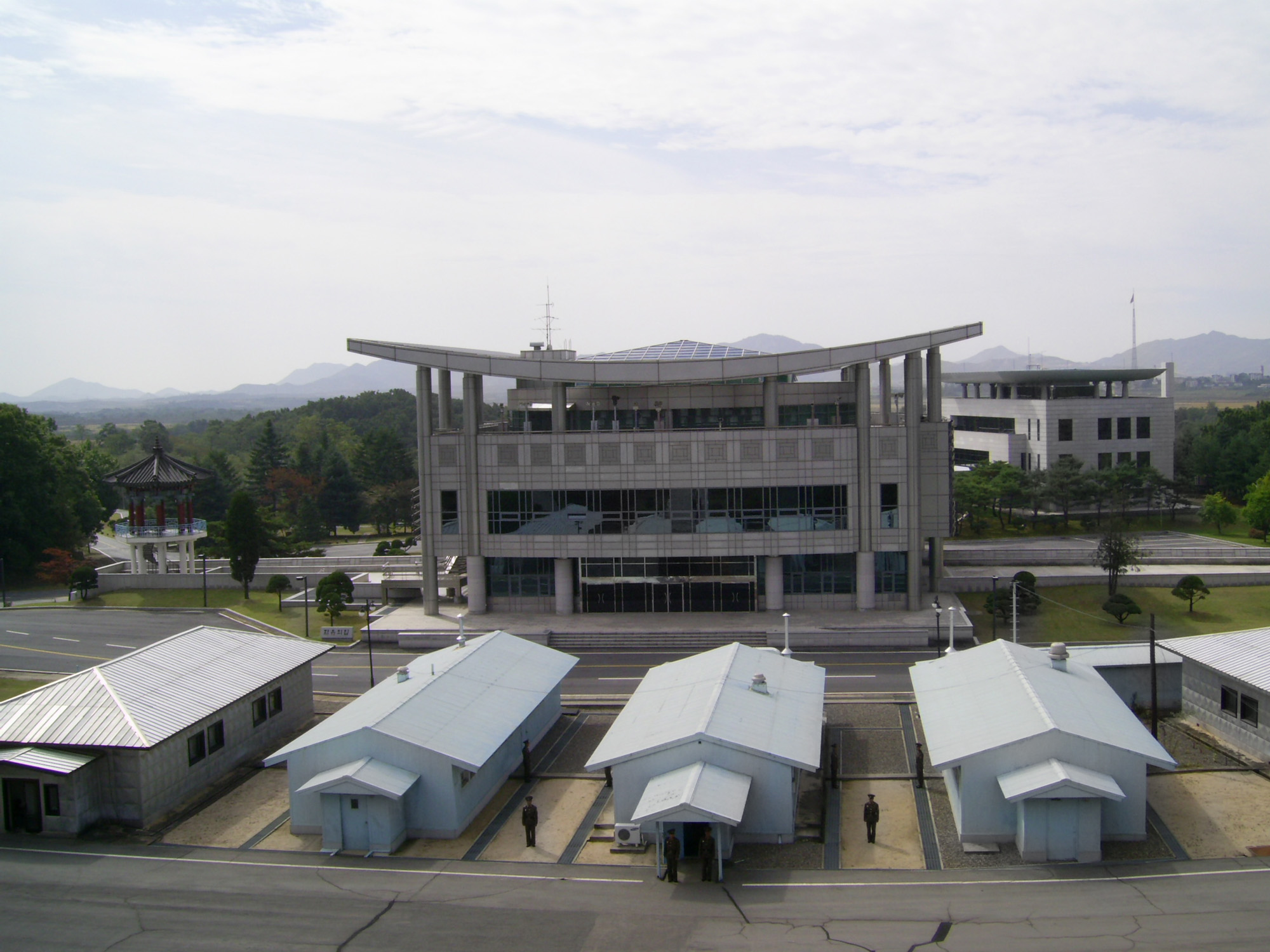 The Joint Security Area in the Demilitarized Zone between the two Koreas, looking toward South Korea from the North. The buildings are collectively called Conference Row. (Photo by Typhoonchaser via Wikimedia Commons)