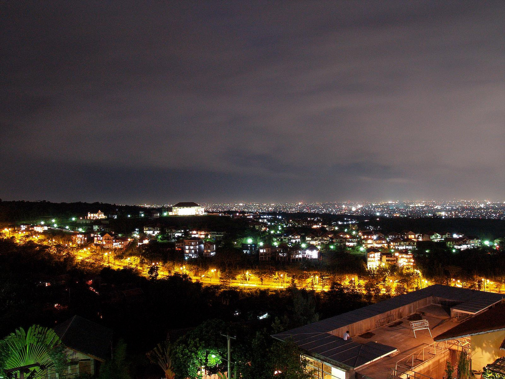 Bandung at night. The city is the third largest in Indonesia with a population of 2.4 million in 2010. It is also sometimes called the City of Flowers. (Photo by Russavia via Wikimedia Commons)