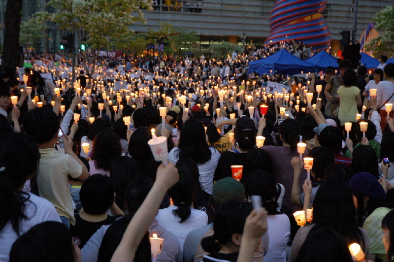 Thousands of protesters hold candles to show solidarity against the importation of U.S. beef in May 2008.