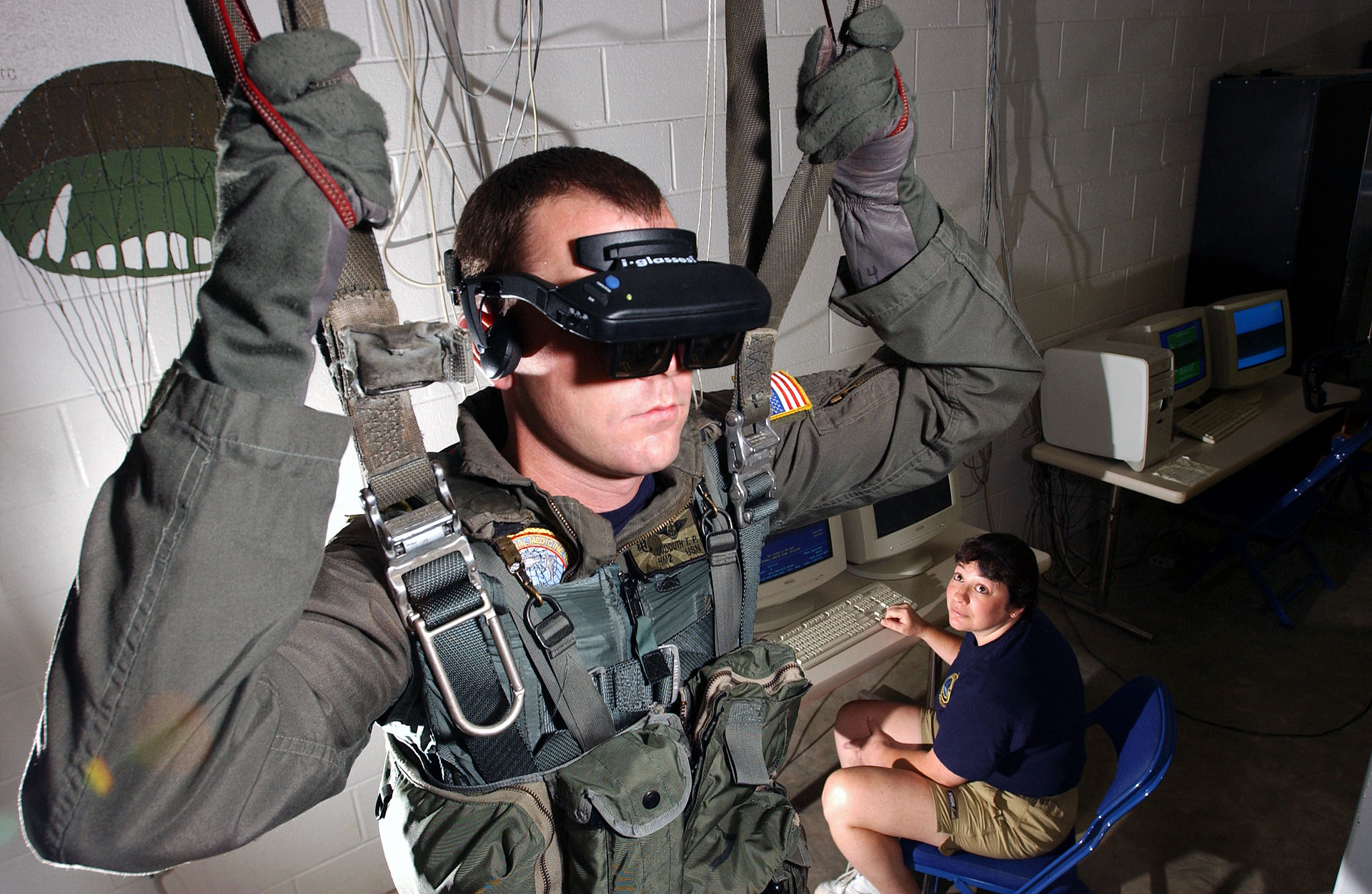 U.S. Navy personnel using a VR parachute trainer.