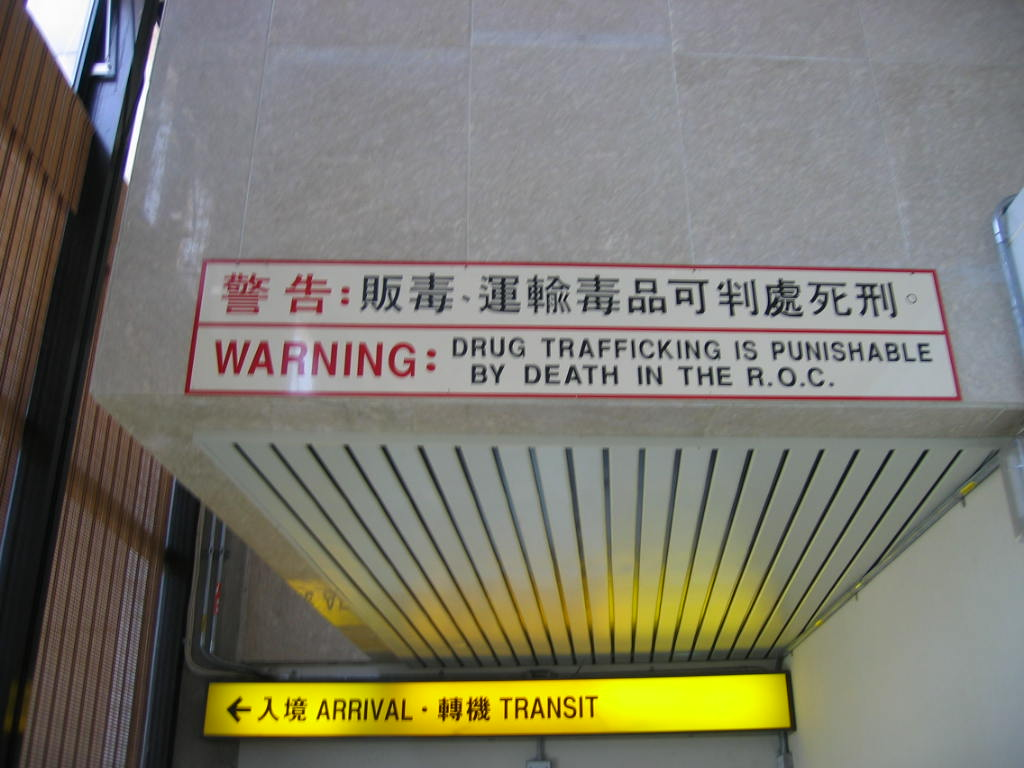 A sign at the Taiwan Taoyuan International Airport warns arriving travelers that drug trafficking is a capital offense in the Republic of China.