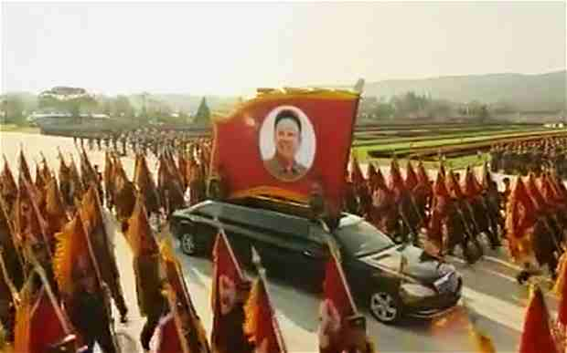 An expensive Mercedes-Benz limousine carrying a flag with Kim Il-sung's face on it has showed up in a North Korean parade.