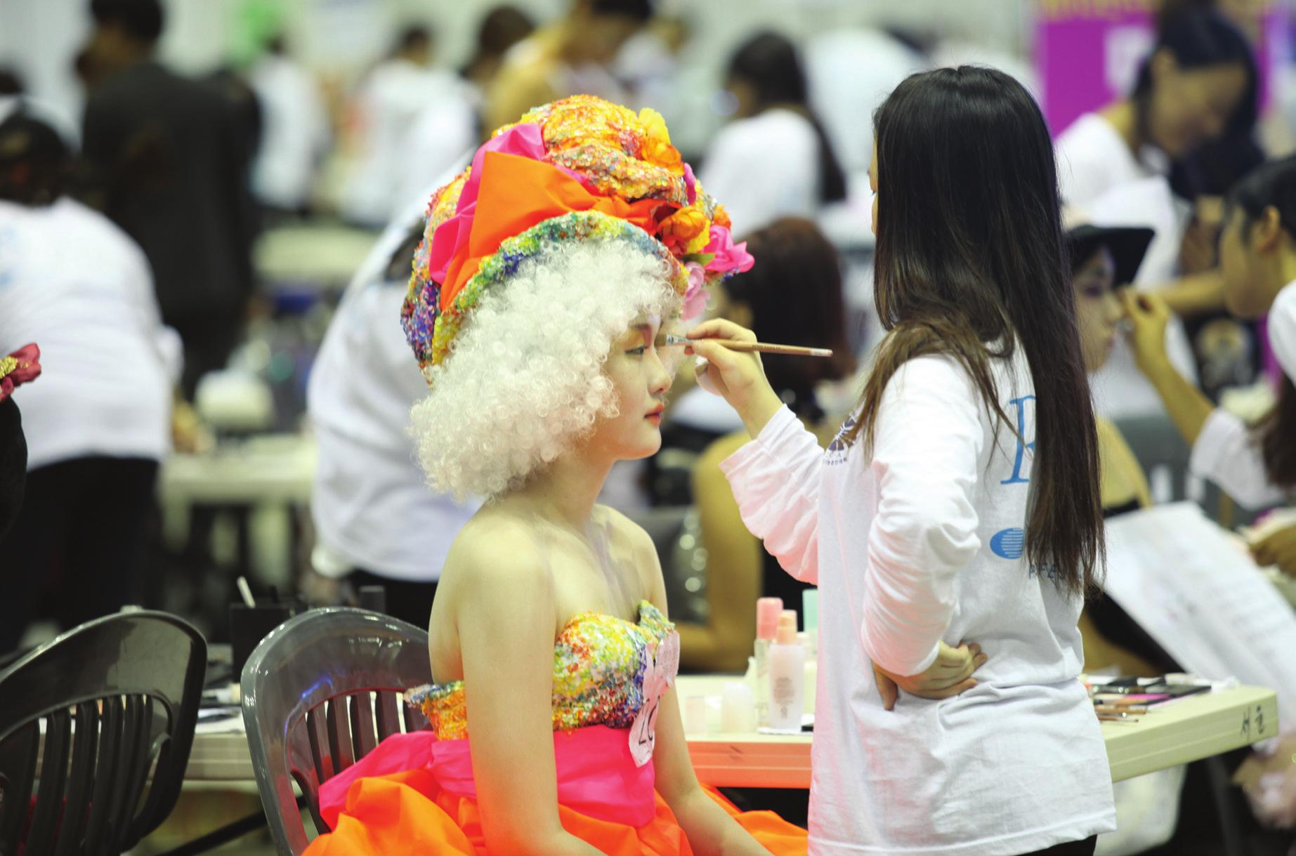 A model prepares for an event at last year's K-Beauty Expo.