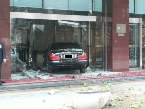 A car after running into the lobby of a KB bank, most likely a victim of sudden unintended acceleration.
