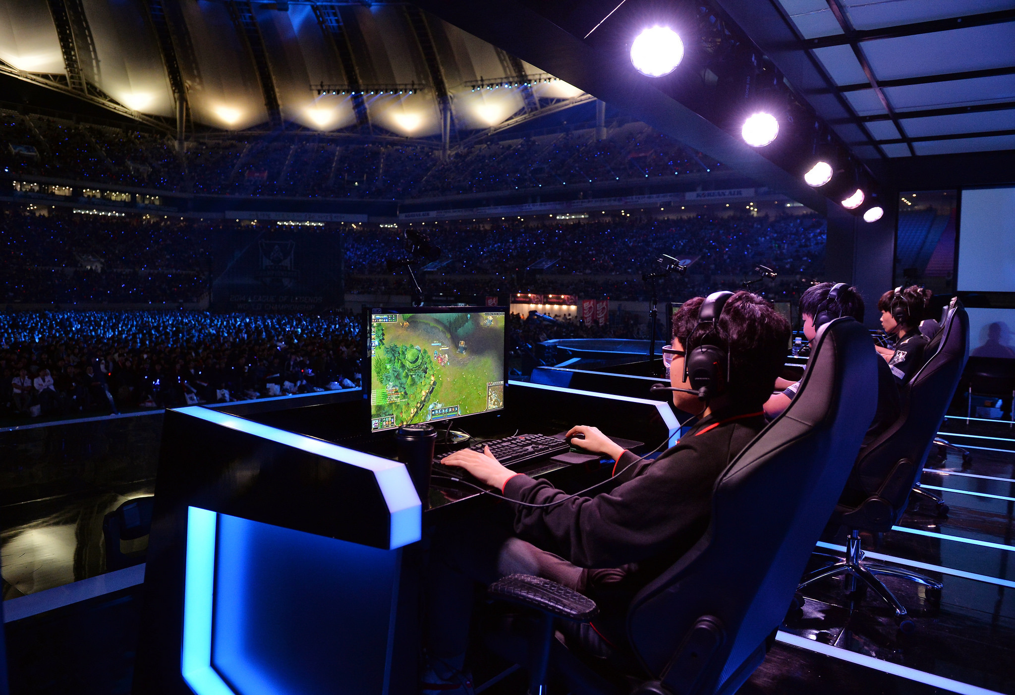 40,000 cheering fans watch the League of Legends gaming final match at World Cup Stadium in Seoul on Oct. 20.