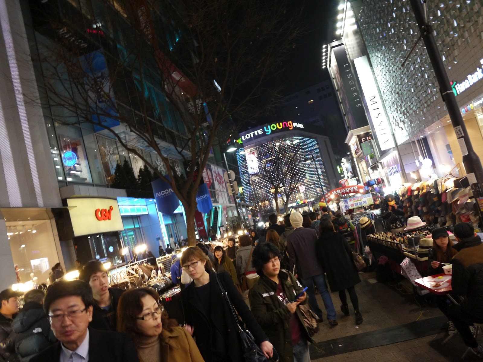 The streets of the Myeongdong district of Seoul are quite crowded every night with many tourists.