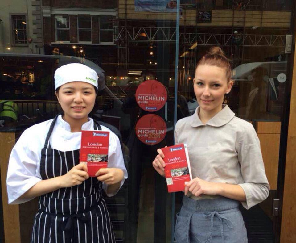 Bibigo staff celebrate the restaurant's inclusion into the Michelin Guide for the second year in a row at the restaurant on Marlborough Street in London.
