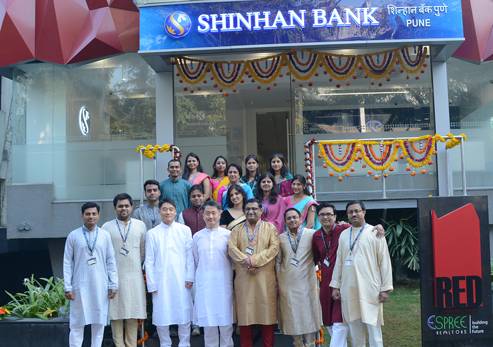 Shinhan Bank's location and staff in Pune, India on opening day.