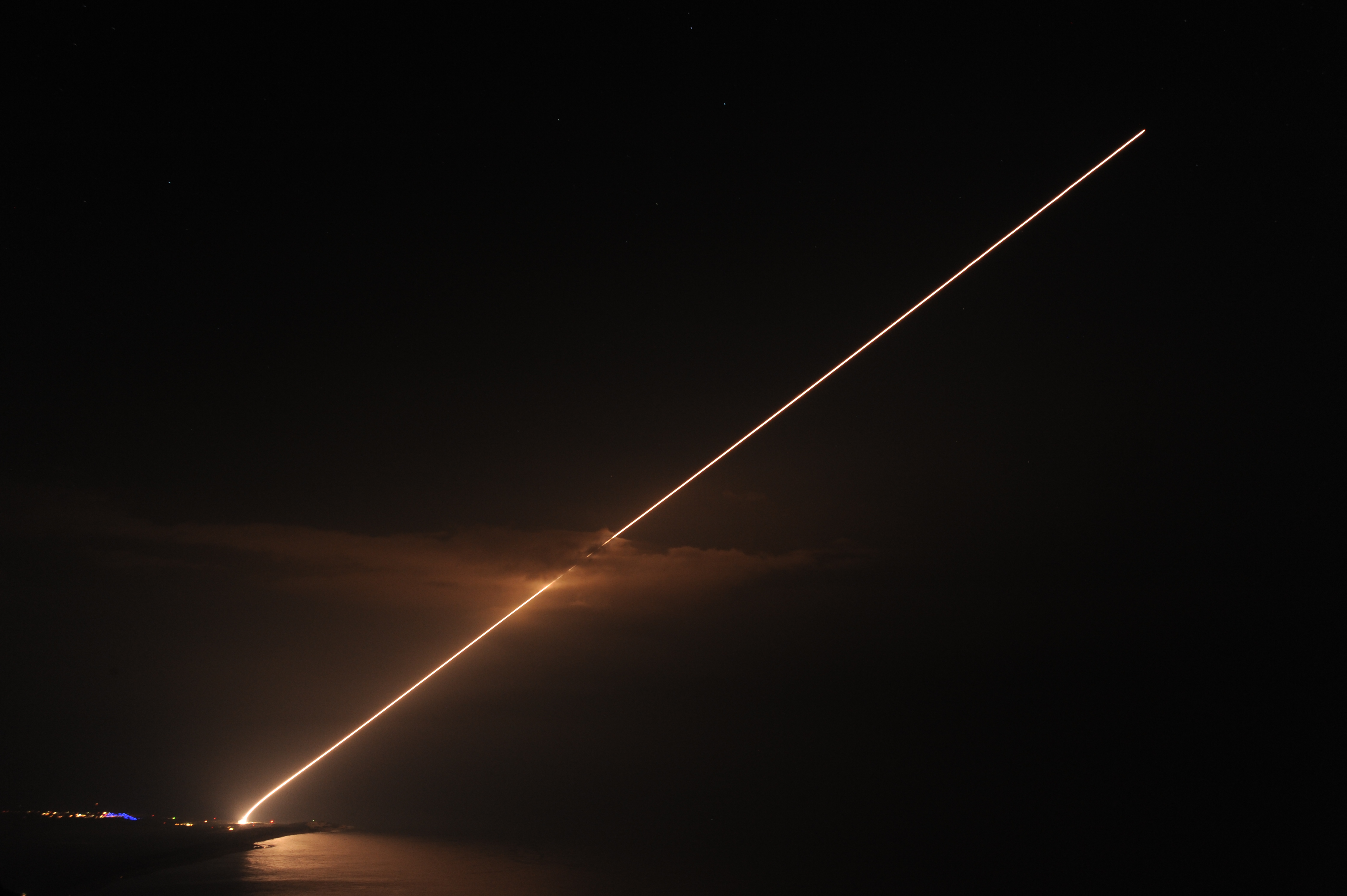 A Terminal High Altitude Area Defense system being fired at night.