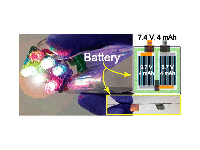 The thin, flexible battery can both bend and power a set of LEDs at the same time.