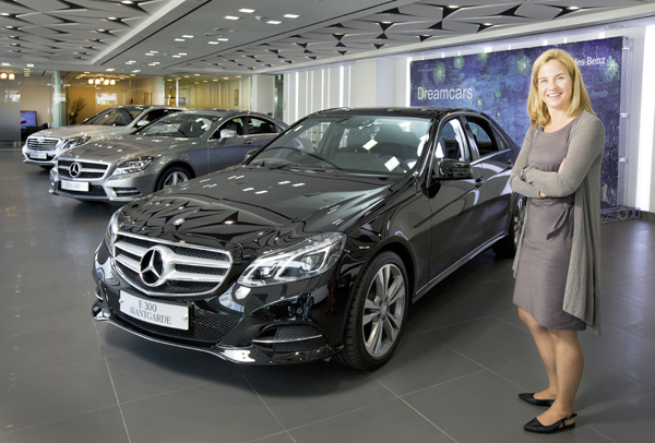 Mercedes-Benz Korea CEO Britta Seeger poses next to an E-Class sedan at an automobile dealer in Yongsan District, central Seoul, on May 26, 2014.