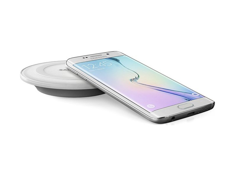 A Samsung Galaxy S6 smartphone and its wireless charging station.