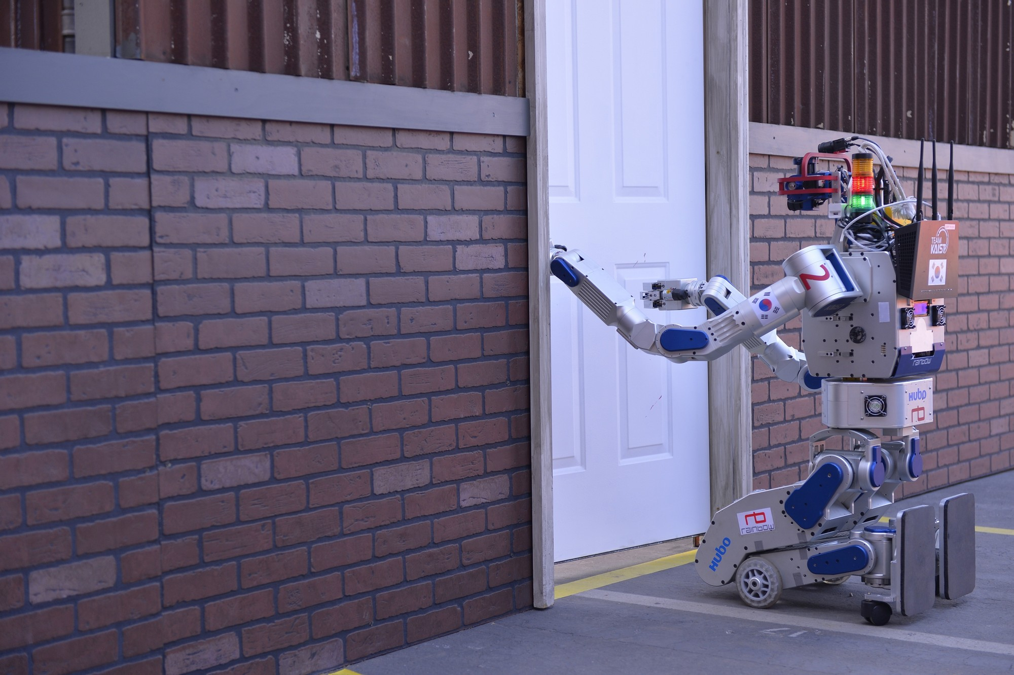 KAIST's HUBO robot opening a door on the first day of the challenge  on June 5.