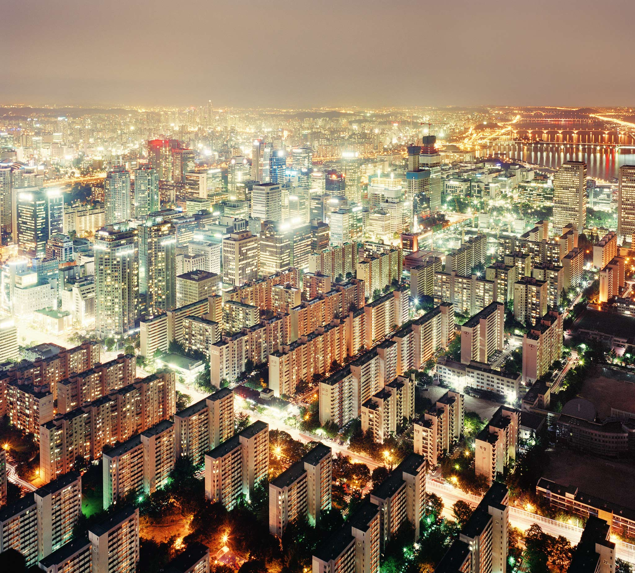 Apartment blocks light up the night sky in Seoul, South Korea.