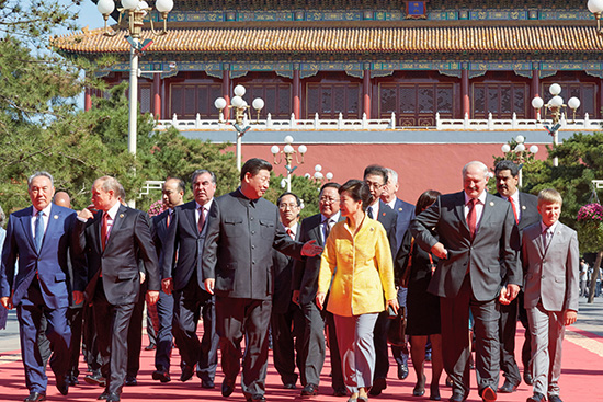 President Park Geun-hye walks to Tiananmen Square with Chinese President Xi Jinping on China's Victory Day event, Sept. 3.