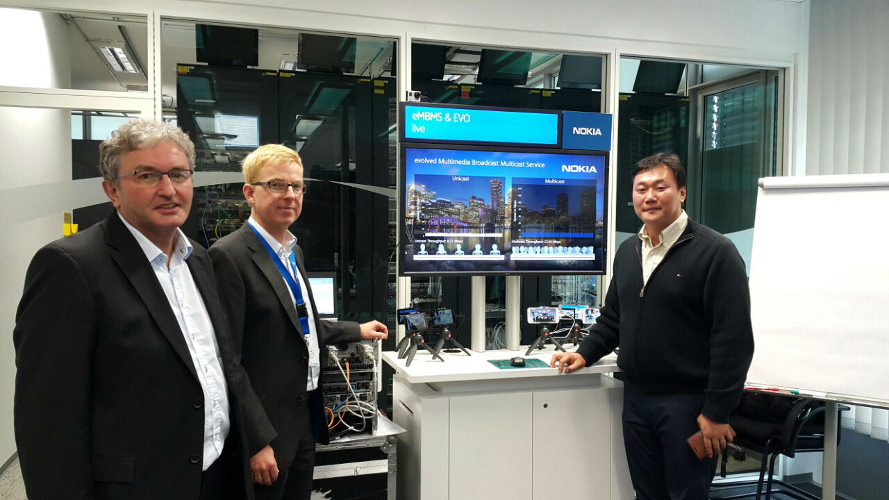 Officials from KT and Nokia pose for a photo after successfully demonstrating a technology at the Nokia Research Center in Munich, Germany.
