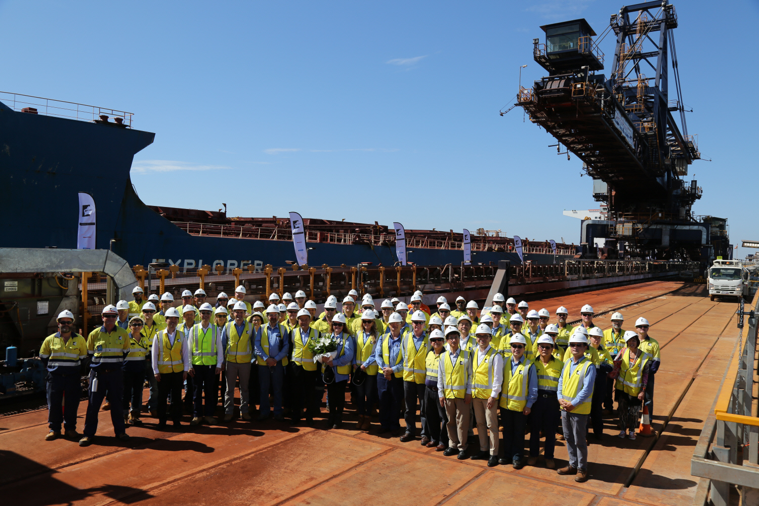 Workers at Port Hedland pose for a photo celebrating the completion of the Roy Hill Project.
