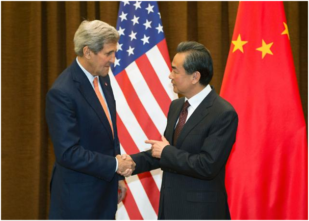 U.S. Secretary of State John Kerry shakes hands with Chinese Foreign Minister Wang Yi in Beijing, China on Jan. 27.