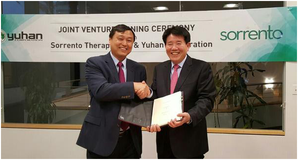 Henry Ji, CEO of Sorrento (left), and Jung Hee Lee, president and CEO of Yuhan (right) pose for a photo.