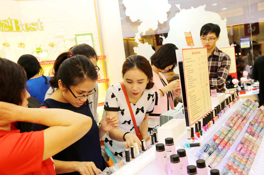 Shoppers are looking at cosmetics items at the Face Shop store in Vietnam.