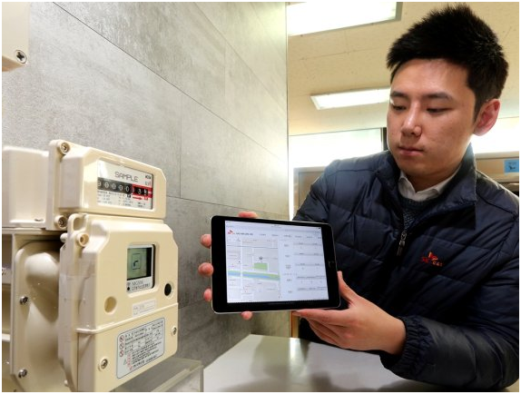 A SK Telecom employee checks data of a smart gas meter embedded IoT modules via a tablet.