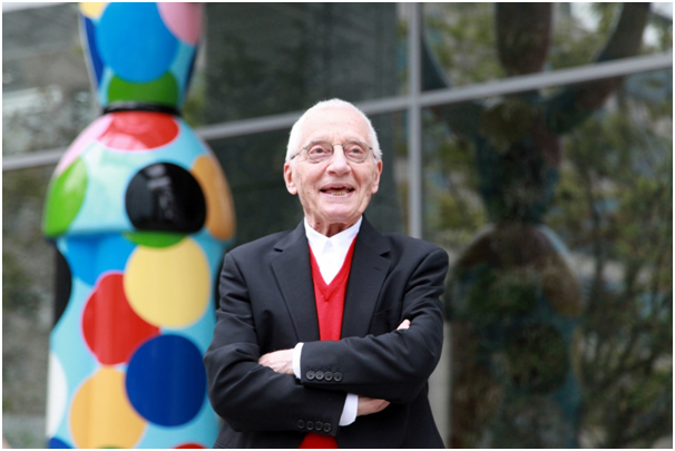 Italian designer Alessandro Mendini poses for a photo in front of his sculpture Mr. Ciao which was built to celebrate the 70th anniversary of SPC Group's foundation.