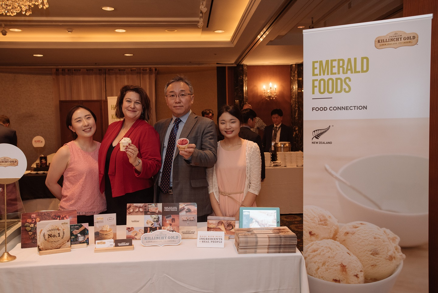 Attendees to New Zealand Food Week show off the fruits of free trade on May 24, 2016.