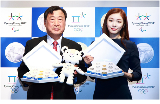 POCOG President LEE Hee-beom (left) and PyeongChang 2018 honorary ambassador and Olympic gold medalist KIM Yuna pose with the first set of the commemorative coins.