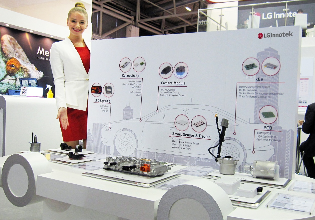 The PR assistant introduces automotive parts in the booth of LG Innotek that participates in the Electronica 2016.