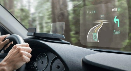 Navdy's head-up display is showing a car navigation service.