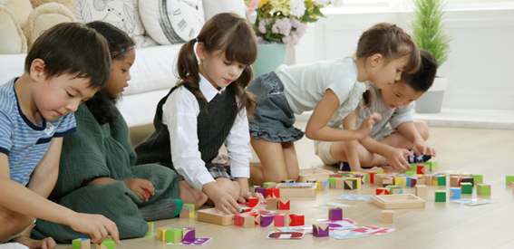 Children playing with Attocube blocks.
