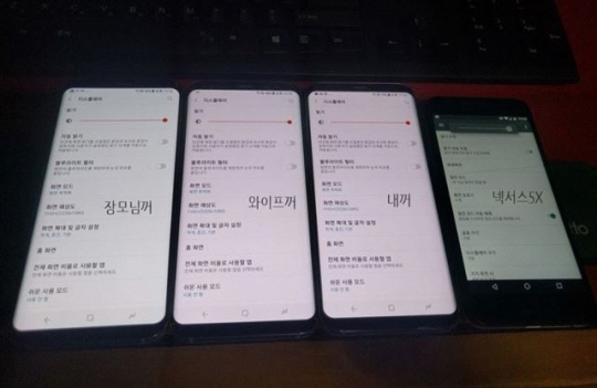 A photo of three Galaxy S8 phones with reddish displays (from left) posted by a customer who preordered the Galaxy S8. Two handsets in the center have excessive red tints on the screen.