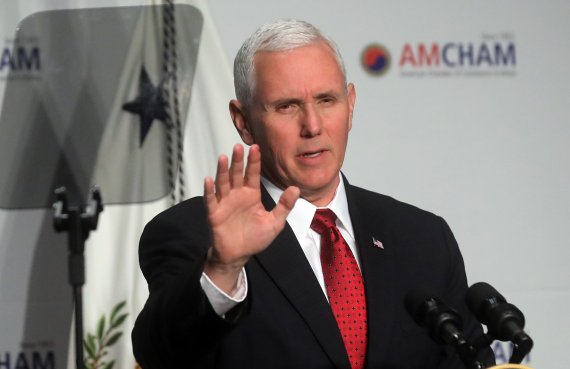 "US Vice President Mike Pence said Washington will ""review and reform"" the KORUS at a meeting of the American Chamber of Commerce in Seoul on April 18."