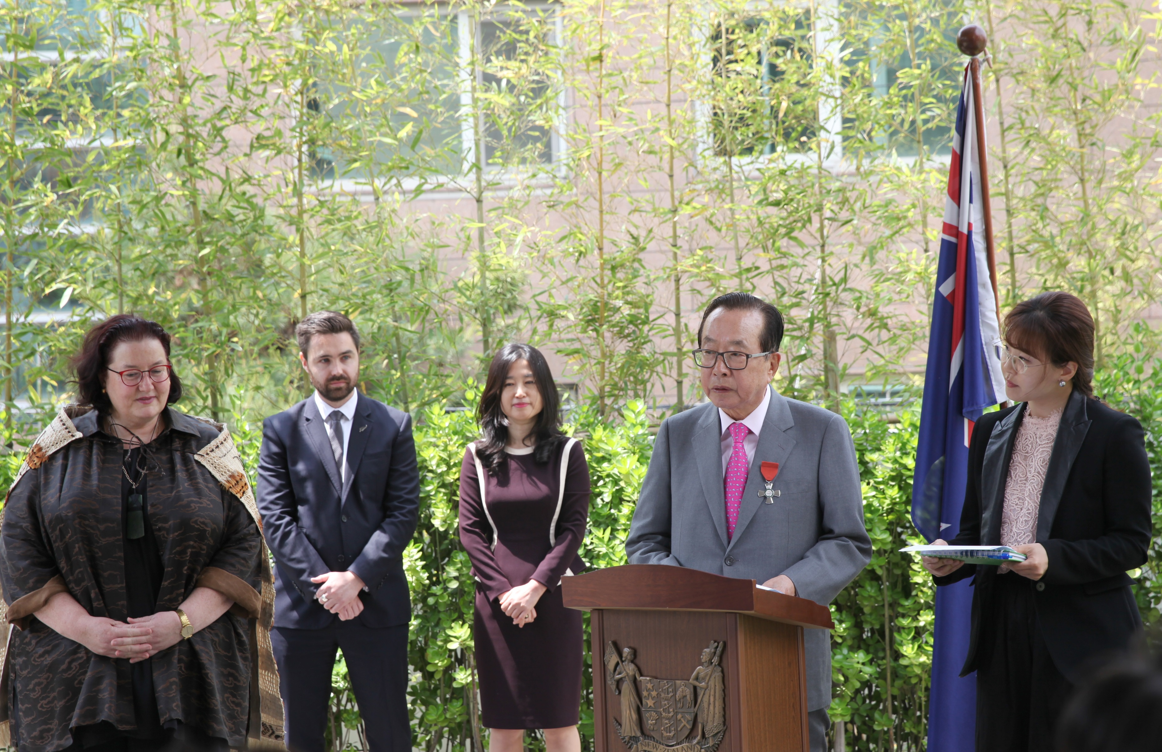 Dongwon Group Chairman Kim Jae-chul speaks at the investiture ceremony of the New Zealand Order of Merit at the New Zealand Residence on May 16.