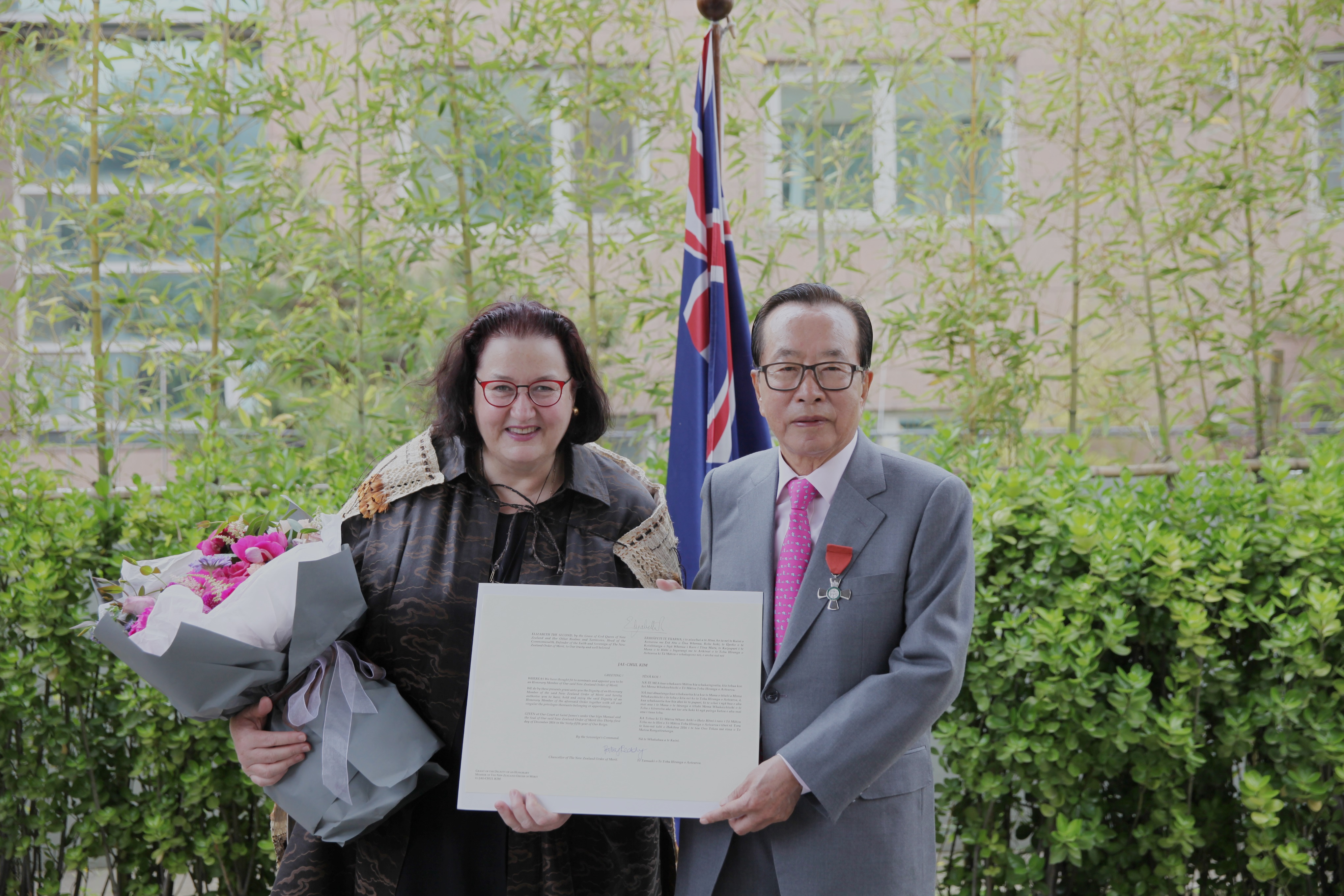 New Zealand Ambassador Clare Fearnley and Dongwon Group Chairman Kim Jae-chul pose for a photo.