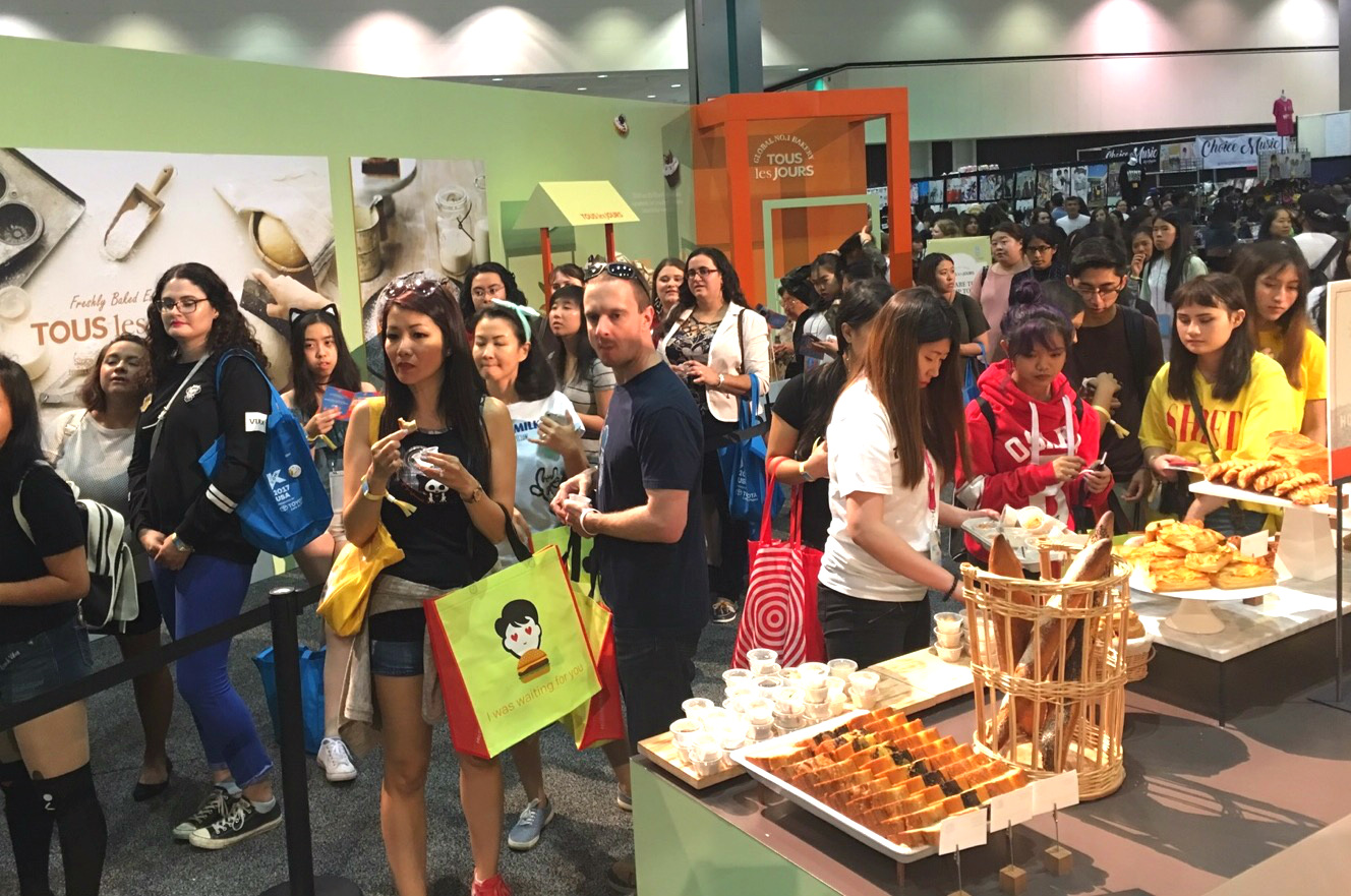 A large number of visitors try Tous Les Jours' popular products in North America at the at booth at the KCON 2017 in L.A.