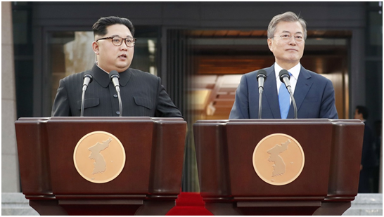 South Korean President Moon Jae-in (right) and North Korean leader Kim Jong-un announces the Panmunjom Declaration in front of the Peace House at Panmunjom after their summit on April 27.