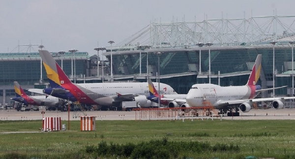 Asiana Airlines planes waiting for departure at Incheon International Airport