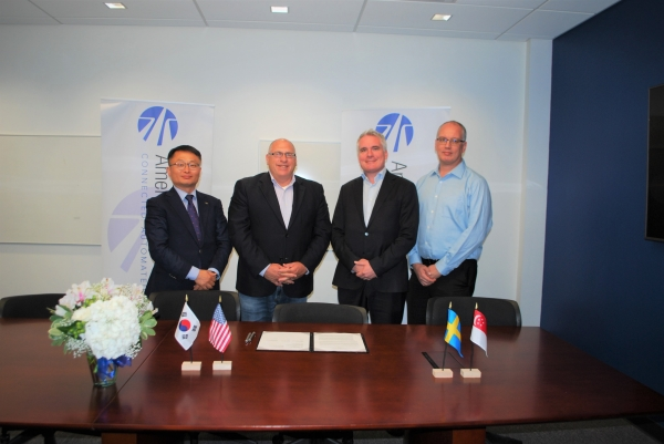 Cho Sung-woo, head of a team at K-City (first from left) is posing for a photo shoot after signing a contract with organizations with self-driving test centers such as the ACM of the US and AstaZero of Sweden in Michigan of the US on June 26.
