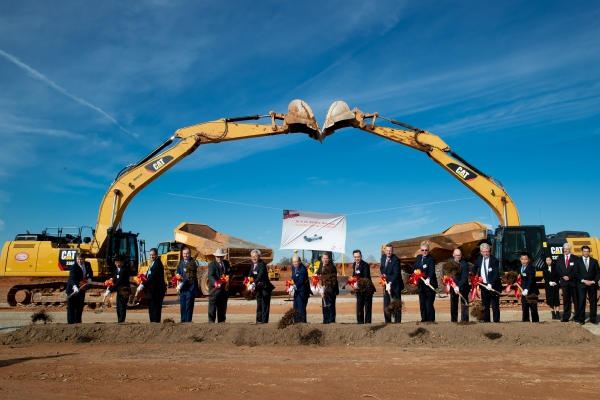 Officials from the U.S. federal and State of Georgia governments and SK Group shovel dirt during a groundbreaking ceremony for SK Innovation's electric vehicle battery plant in Commerce, Georgia of the United States on March 19 (local time).